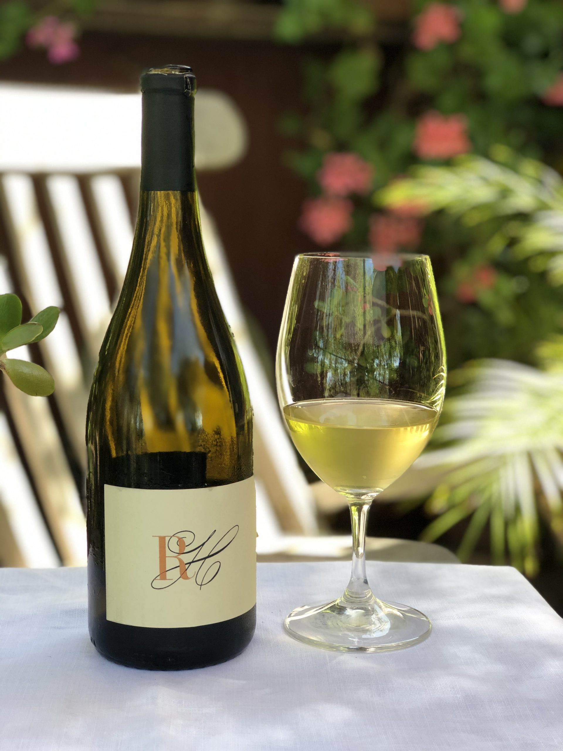 Read-Holland Chardonnay bottle & in glass on patio