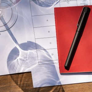 Wine Stems and Red Notebook Ready for wine Tasting